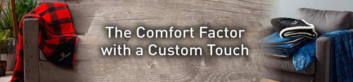 photos of custom blanket corporate gifts on the left and right with the message 'The Comfort Factor with a Custom Touch' displayed