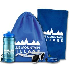 An aqua translucent 20oz water bottle with a white logo with white sunglasses with a blue logo beside it. Behind the bottle there is a blue sports bag with a white logo and a blue rally towel with a white logo