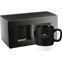 A black 14oz and white ceramic mug with a white logo in front of a two mug gift box with the same mug without a logo inside
