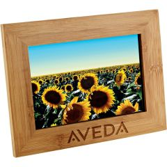 A bamboo horizontal frame engraved and with a picture inside