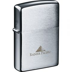 A brushed chrome windproof, silver coloured metal lighter with an engraved logo on the front lower half