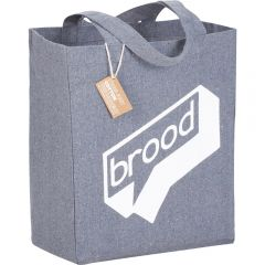 An angled view of a multi-coloured recycled cotton grocery tote with a white logo on the front