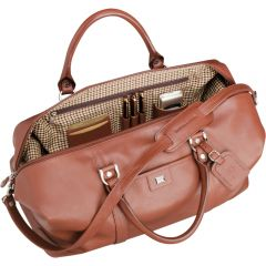 An angled view of a chestnut leather weekend duffle open to show the contents stored inside