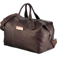An angled view of a mahogany Colombian leather weekend duffel with debossed tag