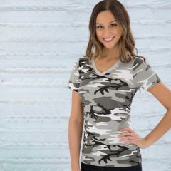 A grey camo coloured ring spun V-neck ladies tee being worn by a blond haired woman with one hand on her hip stood in front of a grey brick wall