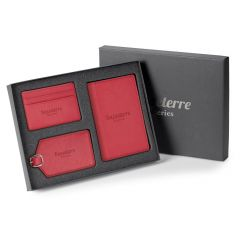 red three piece travel gift set with debossed logo inside grey open gift box with lid half open behind it