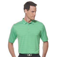 A vibrant green coloured vented polo shirt worn by a man with his hands on his hips