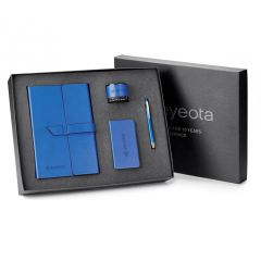 blue tech gift set in open gift box with gift box lid behind it