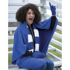 A true royal coloured fleece blanket being worn by a woman sitting on a bench wearing a blue and white game scarf with one arm raised in the air
