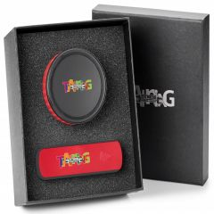 red and black speaker charger and power bank in open gift box with lid half hidden behind it