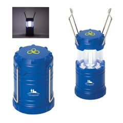 Two royal blue lantern lights both with yellow logos one in the open position and one closed with a lifestyle example picture in the top right corner