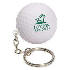 A white golf ball shaped stress reliever with a green logo and a metal keychain and split ring attached