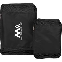 Two black packing cubes the one on the left is larger with a white logo beside a smaller blank one