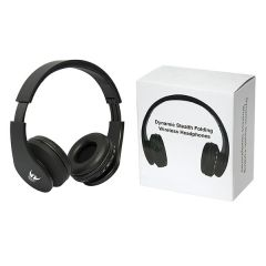 A pair of black over the head wireless headphones with a white logo on the side. The headphones are beside a white box with a picture of the headphones on