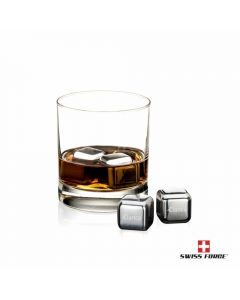 Four stainless steel branded ice cubes, two inside a glass filled with liquid and two outside on display