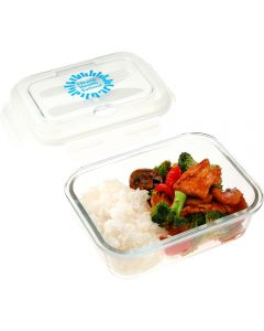 An angled view of a rectangular glass 1000mL food storage container uncapped and filled with food. Behind it is the clear lid with a knife and fork inside and a blue logo on the outside