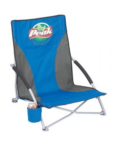 The angled front view of a royal blue and grey coloured low sling 300lb capacity beach chair with a full colour logo on the front and a can cooler with a can on it also