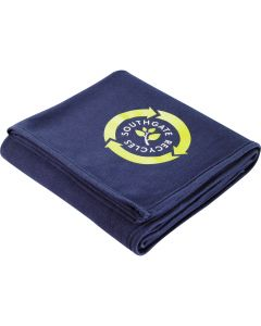 "A navy hemmed 50""x60"" blanket folded up and showing a full colour logo"