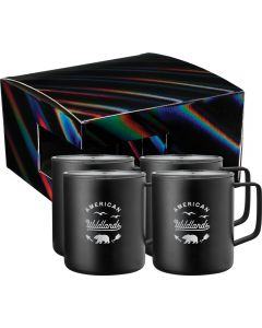 Four black stainless steel 14oz mugs stacked 2 by 2 with the nearest two showing silver logos. Behind the mugs is a black holographic gift box