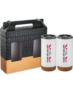 Two white copper vacuum tumblers with full colour logos, cork bottoms and black lids in front of a black and cork print style gift box