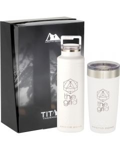 A white copper thermal vacuum  20oz bottle and a 20oz tumbler with silver accents and silver logos in front of a black and translucent gift box