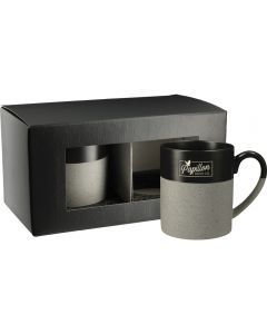 Two 2 tone 15oz ceramic mugs with grey speckled bottoms and black gloss tops. The one in front has a white logo and the other is unbranded and inside a black gift box