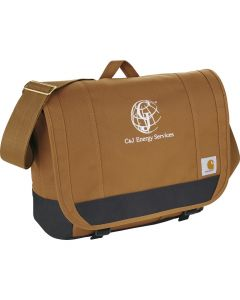 An angled view of a brown with black accents computer messenger bag with a white logo