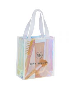 An angled view of an iridescent gift tote with a grey logo on the front. The material is translucent and inside the bag three beauty products can be seen