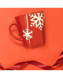 two images of red 350mL mug one side showing green and yellow logo and the other side showing white snowflake print