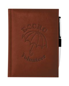 A terra cotta bound JournalBook with a pen attacked to the side and a debossed logo on the front