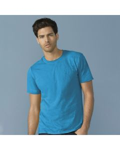 A sapphire softstyle round neck T-shirt being worn by a man with one hand in his pocket