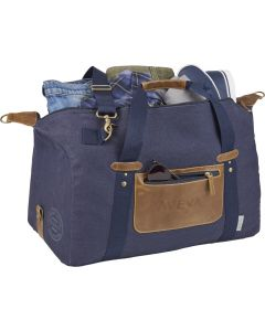 "An angled view of a navy cotton canvas and vinyl 20"" duffle bag that is open at the top to show the contents stored within. The bag also has a debossed logo on the front"