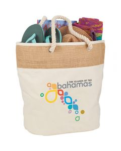 The angled view of a 12oz cotton canvas and jute tote bag with a full colour logo, rope handles and filled with goods