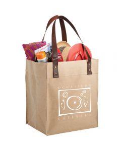 An angled view of a natural coloured cotton and jute bag with a white full colour logo, brown vinyl handles and filled with goods