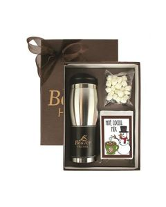 An open gift set showing a 16oz stainless steel insulated tumbler, a packet of marshmallows and a cocoa packet with a snowman on the front. The tumbler has a gold coloured logo on the dark grip. Behind the gift box and slightly hidden is the brown lid for