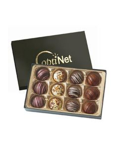 An open gift box with 12 assorted truffles inside. Behind this and slightly hidden is the black box lid with a gold logo on the front