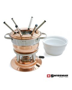 A copper coloured and white ceramic 11pc fondue set with 6 fondue forks resting inside and a white ceramic bowl beside it