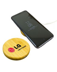 two circle shaped bamboo wireless charge pads one with a black and red logo and one with a black smart phone on top of it