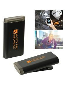 two images of black wireless audio receiver one lying down one standing both with orange logos and two lifestyle images in the top right corner