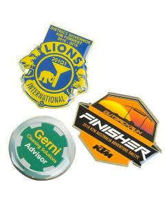 three different coloured full colour epoxy domed lapel pins two custom shaped and one round