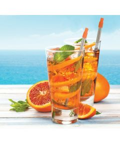 A lifestyle shot of two telescopic stainless straws with orange tips in glasses filled with fruit with more fruit behind them and a picture of the ocean behind that