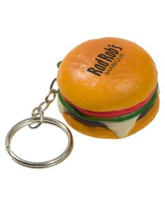A hamburger shaped keychain stress reliever with a black logo on the top and a metal keychain and split ring attached
