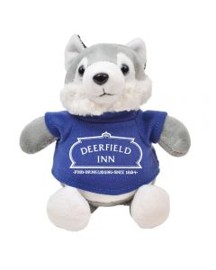 """The front view of a 6"""" husky Plush wearing a blue T-shirt with a white logo on it"""