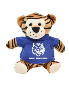 """The front view of a plush 6"""" tiger wearing a blue T-shirt with a white logo"""