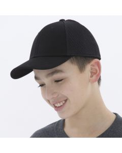 A youth stretch mesh cap with black cotton twill front panels and black mesh side panels being worn by a short haired youth