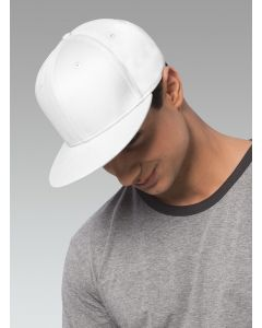 A man in a grey t-shirt wearing a white flat bill snapback cap