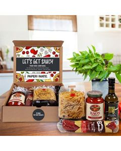 A cardboard box that is open showing food items. These items are a jar of pasta sauce, a salami, a bag of pasta and a bottle of olive oil. These food items are contained inside and a decorated full colour inner lid with a white and black custom logo near
