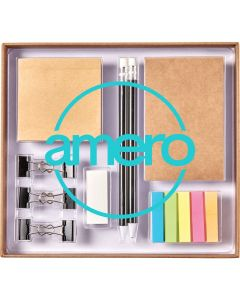 A natural coloured stationery set in it's storage box with sticky notes, pencils, and clips covered with a clear lid showing a blue logo