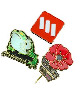 three different shaped lapel pins with different coloured soft enamel