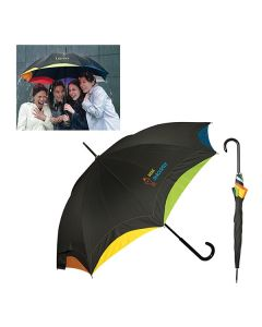 A black open umbrella with a full colour logo and a multi colour underlining with another of the same umbrella closed beside it and a lifestyle shot in the top corner